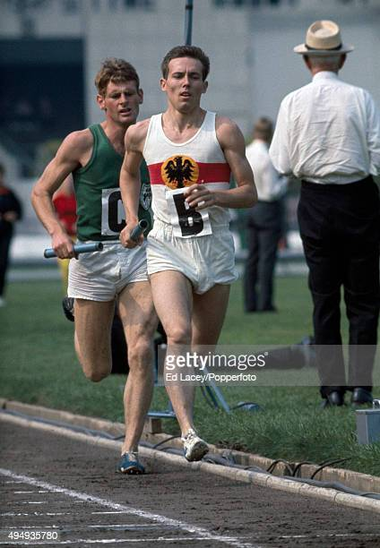 Walter Adams of West Germany leads J Cummins of Ireland in the 4x880 yards relay event at the AAA International athletics meet at White City in...