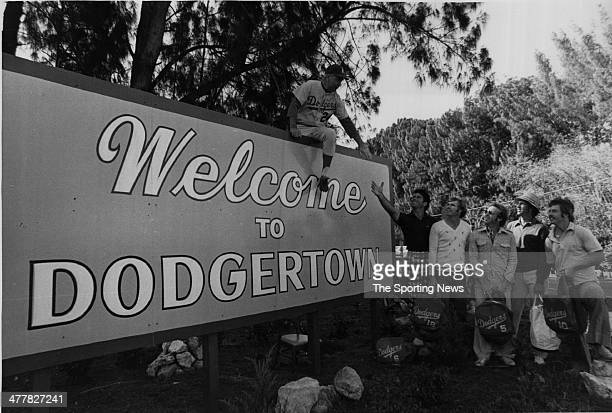 Walter Alston sits on the welcome to Dodgertown sign and welcomes Steve Garvey, Bill Russel, Ted Sizemore, Don Sutton and Ron Cey of the Los Angeles...