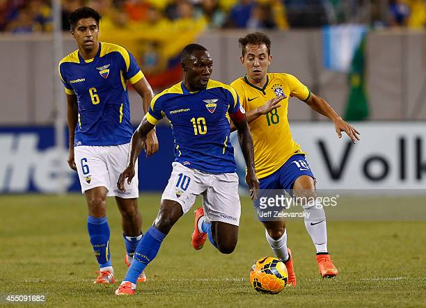 Walter Ayovi of Ecuador fights for the ball with Everton Ribeiro of Brazil during their match at MetLife Stadium on September 9 2014 in East...