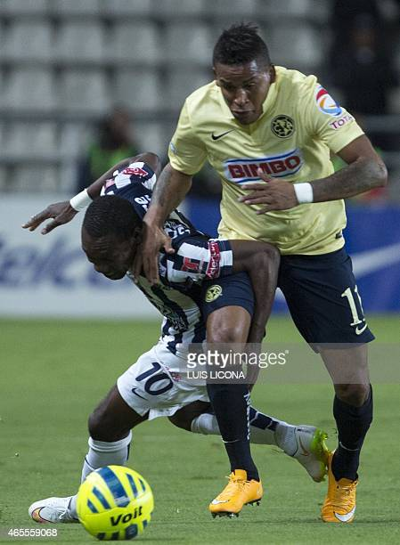 Walter Ayovi of Pachuca vies for the ball with Michale Arroyo of America during their Mexican Clausura tournament football match at the Hidalgo...
