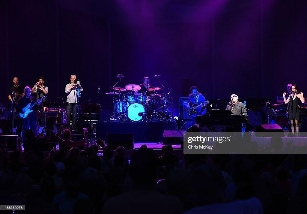 Walter Becker, Michael Leonhart, Jim Pugh, Keith Carlock, Freddie Washington, Donald Fagen, and Carolyn Leonhart of Steely Dan perform at Chastain Park Amphitheater on August 9, 2015 in Atlanta, Georgia.