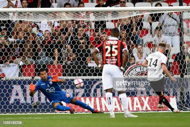 Walter Benitez of Nice stops a penalty shot by Benjamin Bourigeaud of Rennes during the French Ligue 1 match between OGC Nice v Stade Rennais on...