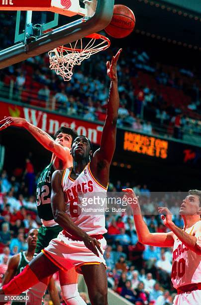 Walter Berry of the Houston Rockets shoots a layup against Kevin McHale of the Boston Celtics during a 1988 NBA game at The Summit in Houston Texas...
