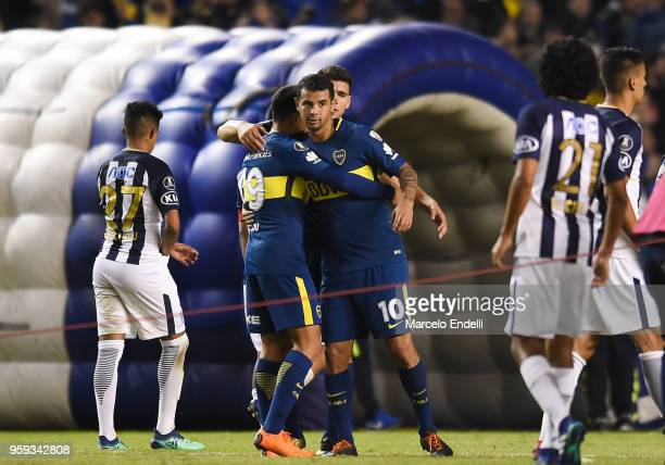 Walter Bou hugs Edwin Cardona of Boca Juniors after winning a match between Boca Juniors and Alianza Lima at Alberto J Armando Stadium on May 16 2018...