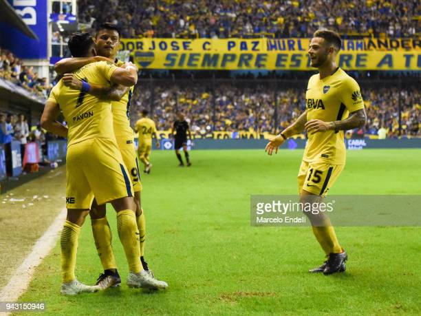 Walter Bou of Boca Juniors celebrates with teammate Cristian Pavón after after Dylan Gissi of Defensa y Justicia scores an own goal during a match...