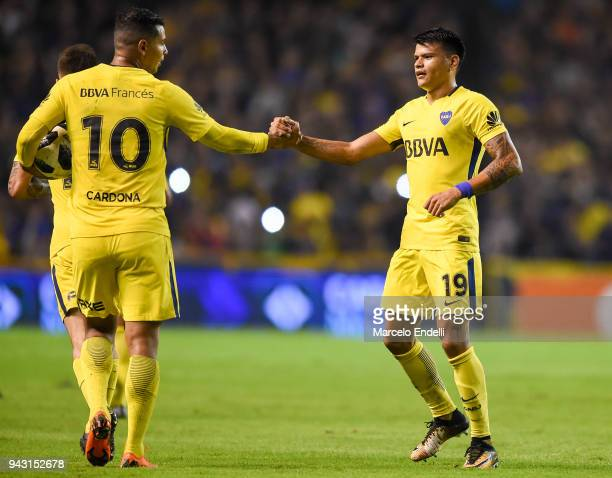 Walter Bou of Boca Juniors celebrates with teammate Edwin Cardona after after Dylan Gissi of Defensa y Justicia scores an own goal during a match...
