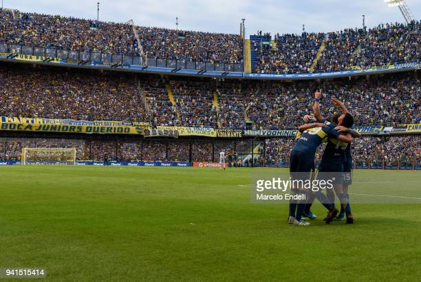 Walter Bou of Boca Juniors celebrates with teammates after scoring the first goal of his team during a match between Boca Juniors and Talleres as...