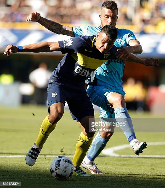 Walter Bou of Boca Juniors fights for the ball with Adrian Arregui of Temperley during a match between Boca Juniors and Temperley as part of eighth...