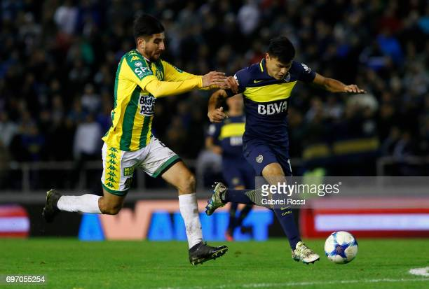Walter Bou of Boca Juniors fights for the ball with Alan Alegre of Aldosivi during a match between Aldosivi and Boca Juniors as part of Torneo...