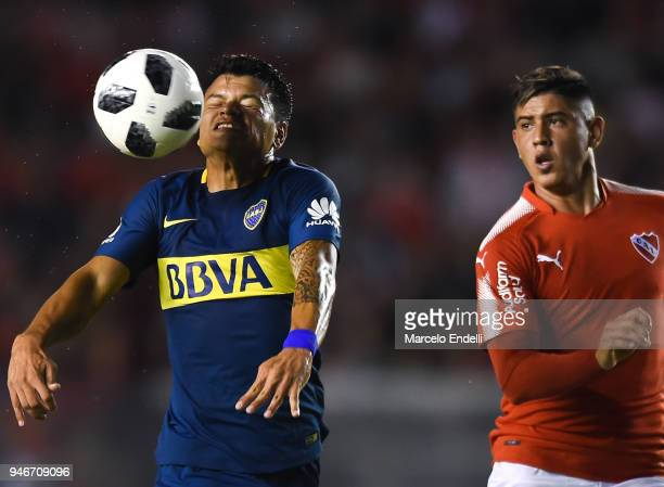 Walter Bou of Boca Juniors fights for the ball with Alan Franco of Independiente during a match between Independiente and Boca Juniors as part of...