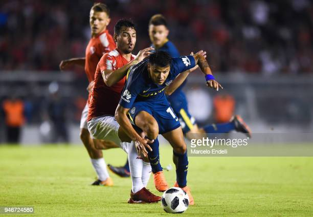 Walter Bou of Boca Juniors fights for the ball with Juan Sanchez Miño of Independiente during a match between Independiente and Boca Juniors as part...