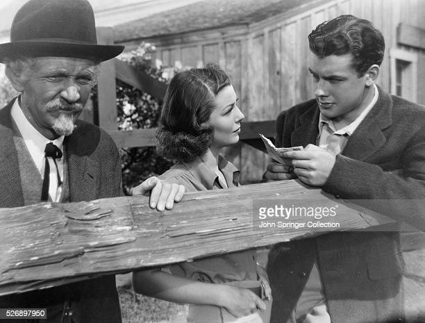 Walter Brennan as Peter Goodwin Loretta Young as Sally Goodwin and Richard Greene as Jack Dillon in the 1938 film Kentucky