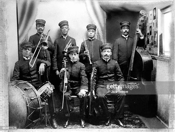 Walter Brundy Peter Bocage Richard Payne Buddy Johnson Bunk Johnson Louis 'Big Eye' Nelson and Billy Marrero of the The Superior Band Of New Orleans...