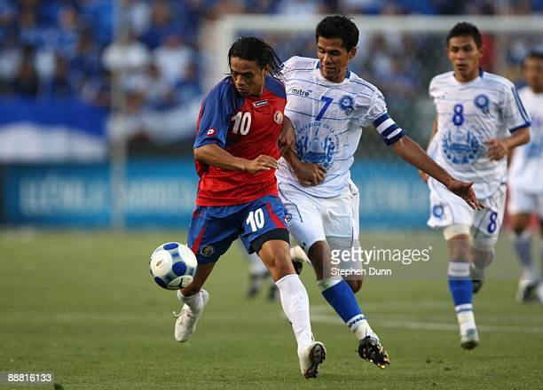 Walter Centeno of Costa Rica moves the ball against Ramon Alfredo of El Salvador during the 2009 CONCACAF Gold Cup at The Home Depot Center on July 3...