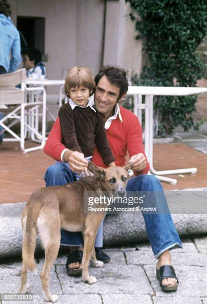 Walter Chiari Italian actor comician and TV host and his son Simone the child he had with the Italian singer and actress Alida Chelli petting the dog...
