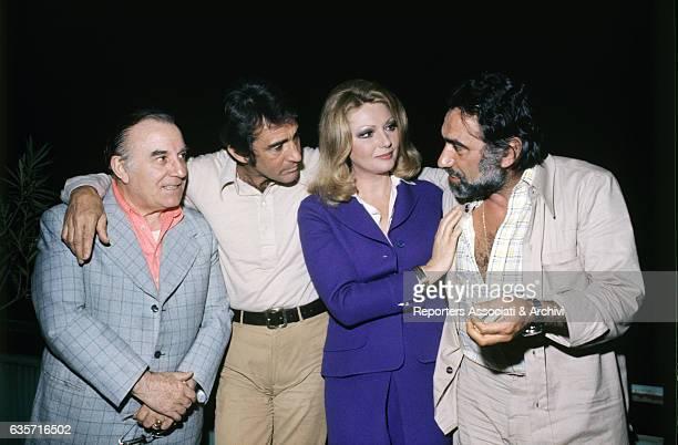 Walter Chiari Italian actor comician and TV host posing with the Italian actors Carlo Campanini Sylva Koscina and Alberto Lupo at the end of their...