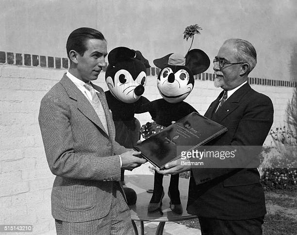 Walter Disney creator of Silly Symphonies was today presented a diploma of commendation from the National Academy of Fine Arts of Buenos Aires...