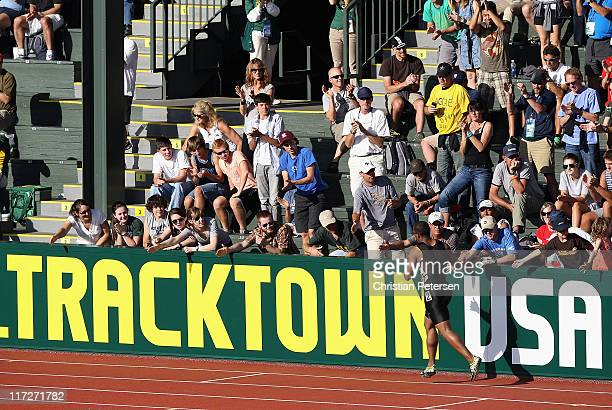 Walter Dix high-fives fans after winning the Men's 100 meter dash final on day two of the USA Outdoor Track & Field Championships at the Hayward...