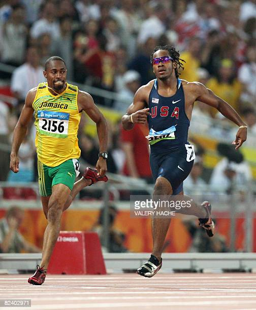 Walter Dix of the US and Jamaica's Christopher Williams compete in the men's second round 200m heat 2 at the Bird's Nest National Stadium during the...