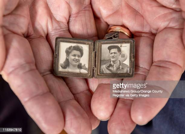 Walter Drake holds a locket he carried after his fighter squadron was sent to England during World War II in Newport Beach on Sunday June 2 2019 The...