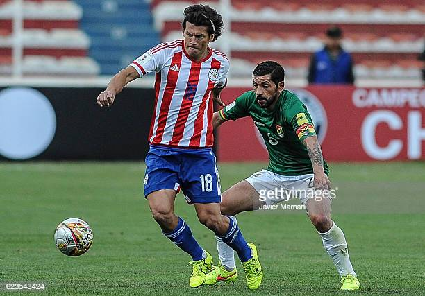 Walter Flores of Bolivia fights for the ball with Nelson Haedo Valdes of Paraguay during a match between Bolivia and Paraguay as part of FIFA 2018...
