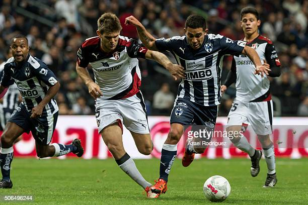 Walter Gargano of Monterrey fights for the ball with Walter Kannemann of Atlas during the 3rd round match between Monterrey and Atlas as part of the...