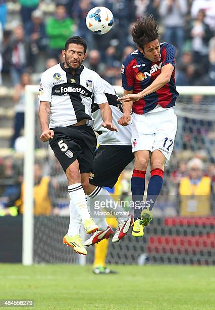 Walter Gargano of Parma FC competes with Robert Acquafresca of Bologna FC during the Serie A match between Bologna FC and Parma FC at Stadio Renato...