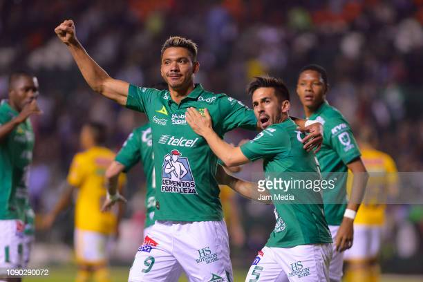 Walter Gonzalez of Leon celebrates with teammate Fernando Navarro after scoring the first goal of his team during the first round match between Leon...