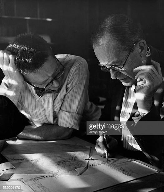 Walter Gropius founder of Bauhaus design school looks over blueprints with a student