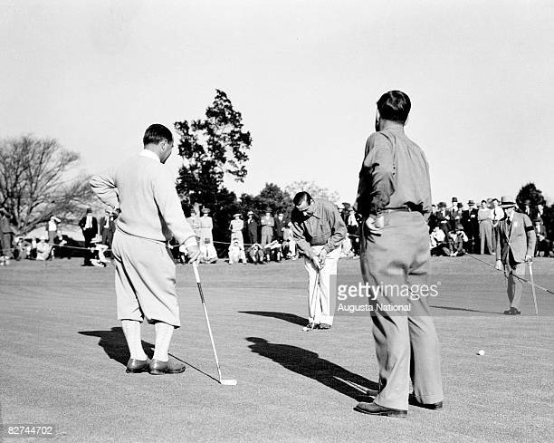 Walter Hagen plays a putt while Gene Sarazen Bobby Jones and the Duke of Windsor watch during the 1935 Masters Tournament at Augusta National Golf...