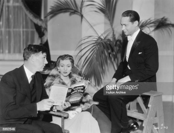 Walter Huston who plays President Judson Hammond in the film 'Gabriel Over the White House' reading the original novel by T F Tweed to costars Karen...