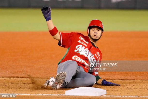 Walter Ibarra Tomateros of Culiacan of Mexico sweeps into third base against Aguilas Cibaenas of Republica Dominicana during the Caribbean Baseball...