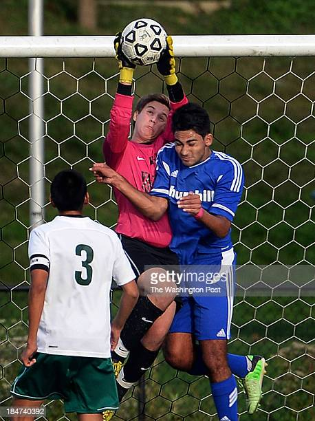 Walter Johnson goalie Ben Meyers saves the ball in front of Churchill's Sepehr Hoghoogi during the game at Walter Johnson High School on Tuesday...