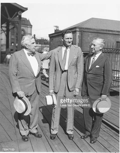 Walter Johnson stands on the railroad platform flanked by Cleveland Indians team official LC Tomlinson and team owner Alva Bradley Johnson had been...