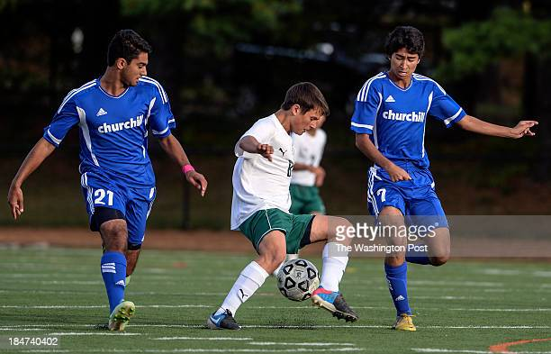 Walter Johnson's Thomas Stavrou center tires to turn the ball in between two Churchill players during the game at Walter Johnson High School on...