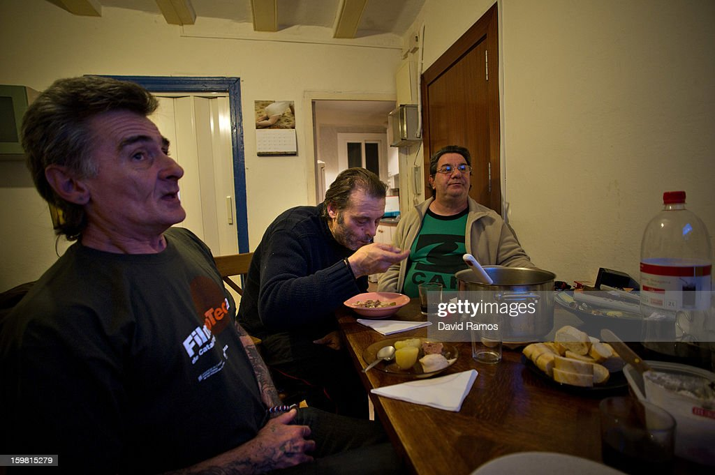 Walter, Juan and Eduardo share a meal at 'El Chinguito de Dios' (The Stall of God) on January 14, 2013 in Barcelona, Spain. The German pastor Wolfgang Striebinger has lived in Barcelona since 1991, originally employed to minister to youths during the Barcelona Olympic Games, he decided to stay and since 2000 has run 'El Chinguito de Dios' (The Stall of God). In his mission to support the homeless, Wolfgang and his volunteers offer a place for up to 200 people to come and have some food daily and also offering them assistance with grooming and clothes. Many of the volunteers are homeless and help out in return for meals and a bed. Wolfgang's ethos is to provide peace, calm and dignity to all those that need it amongst Barcelona's burgeoning homeless population. Due to the economic situation his doors are now also open to the long term unemployed and families with little or no income. According to the latest figures 21.8% of the Spanish populations are living below the poverty line.