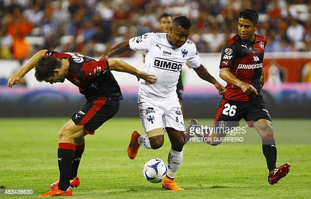 Walter Kannemann and Juan Medina of Atlas vie for the ball with Dorlan Pabon of Monterrey during their Mexican Apertura2015 tournament football match...