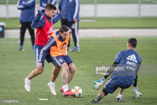 Walter Kannemann of Argentina and Angel Di Maria of Argentina battle for the ball during the training session of Argentina on March 19 2019 in Madrid...