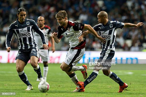 Walter Kannemann of Atlas fights for the ball with Aldo de Nigris and Carlos Sanchez of Monterrey during the 3rd round match between Monterrey and...