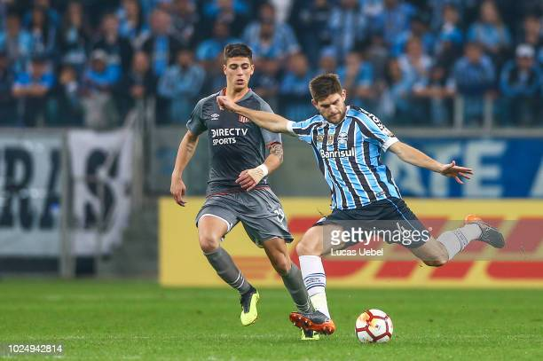 Walter Kannemann of Gremio battles for the ball against Apaolaza of Estudiantes during the match between Gremio and Estudiantes part of Copa Conmebol...