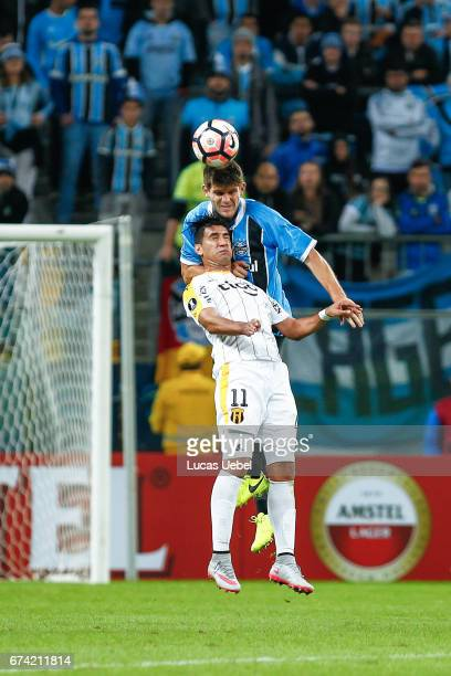 Walter Kannemann of Gremio battles for the ball against Epifanio Garcia of Guarani during the match Gremio v Guarani as part of Copa Bridgestone...