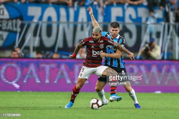 Walter Kannemann of Gremio battles for the ball against Gabriel Barbosa of Flamengo during a semi final first leg match between Gremio and Flamengo...