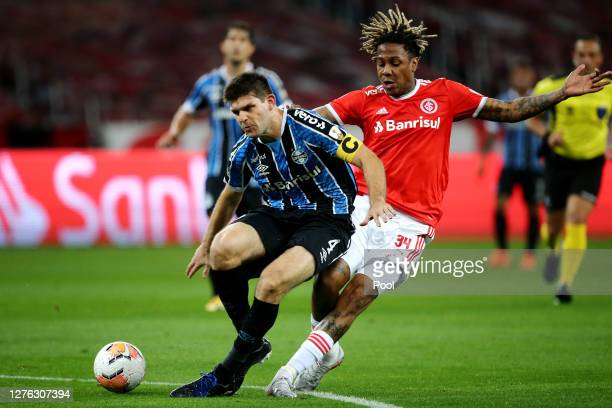 Walter Kannemann of Gremio fights for the ball with Abel Hernández during a group E match of Copa CONMEBOL Libertadores 2020 between Internacional...