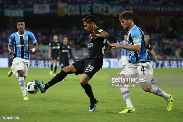 Walter Kannemann of Gremio in action against Omar Gonzalez of Pachuca during the 2017 FIFA Club World Cup semifinal soccer match between Gremio and...