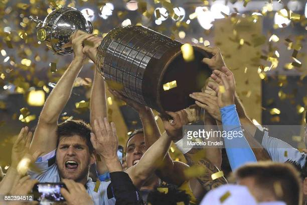 Walter Kannemann of Gremio lifts the champions trophy after the second leg match between Lanus and Gremio as part of Copa Bridgestone Libertadores...