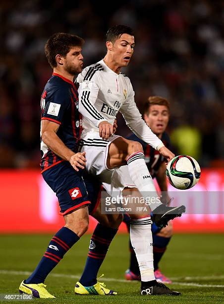 Walter Kannemann of San Lorenzo challenges Cristiano Ronaldo of Real Madrid during the FIFA Club World Cup Final between Real Madrid and San Lorenzo...