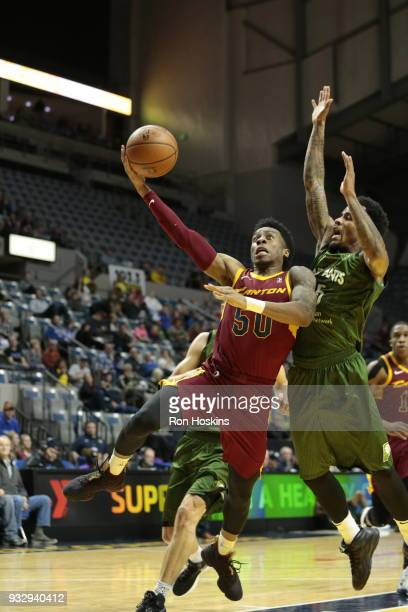Walter Lemon Jr #15 of the Fort Wayne Mad Ants battles Kevin Olekaibe of the Canton Charge on March 16 2018 at Memorial Coliseum in Fort Wayne...