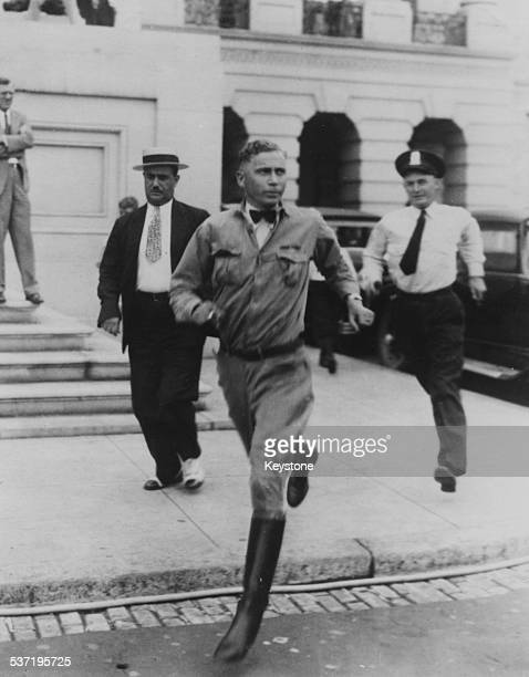 Walter M Waters leader of the Bonus Army running from a police officer during the threatened riot of exsoldiers at the US Capitol Building Washington...