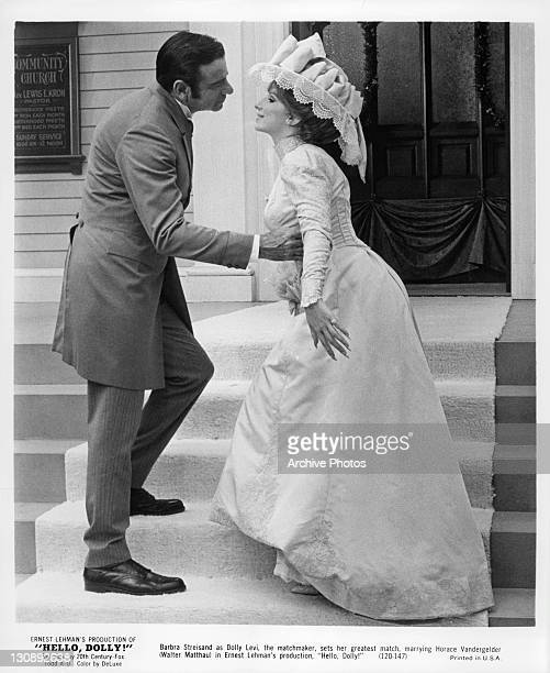 Walter Matthau about to kiss Barbra Streisand in a scene from the film 'Hello Dolly!', 1969.