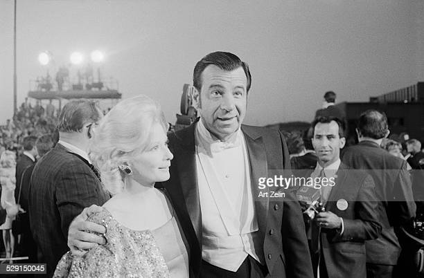 Walter Matthau and Carol Grace his wife at an outdoor formal event circa 1970 New York